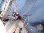 Wrestling the sail down in heavy seas